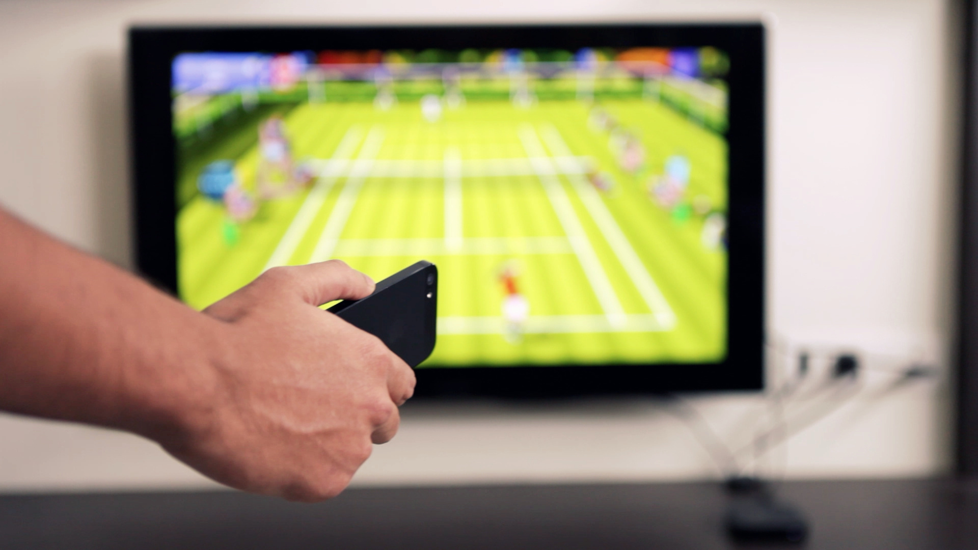 Figure 5: Motion Tennis requires an Apple TV to play, and you use the iPhone or iPod touch as a controller.