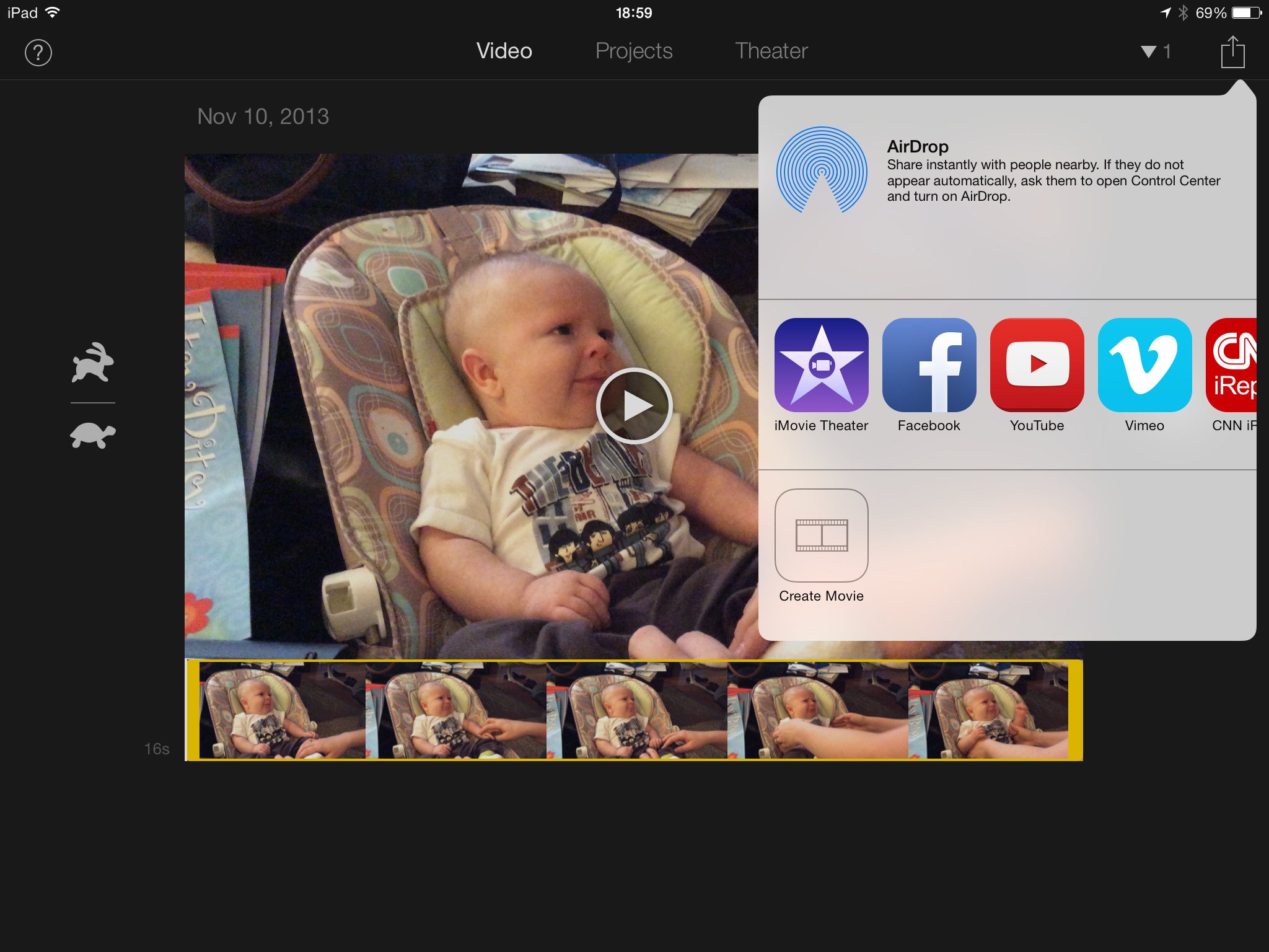 Figure 11: In iMovie for iOS, to upload a video to iMovie Theater, tap the Share button, then tap the purple iMovie Theater button.