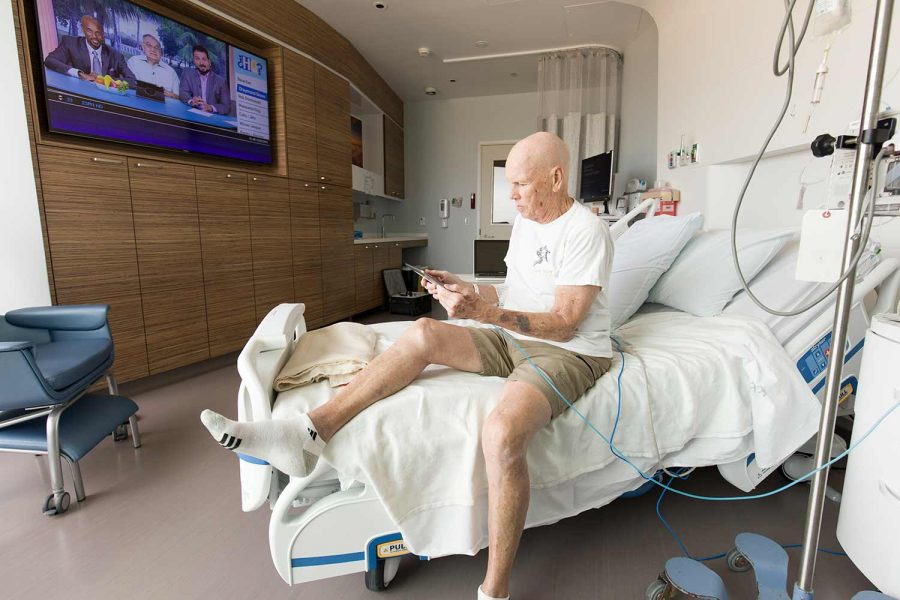 Photo of a patient using an iPad