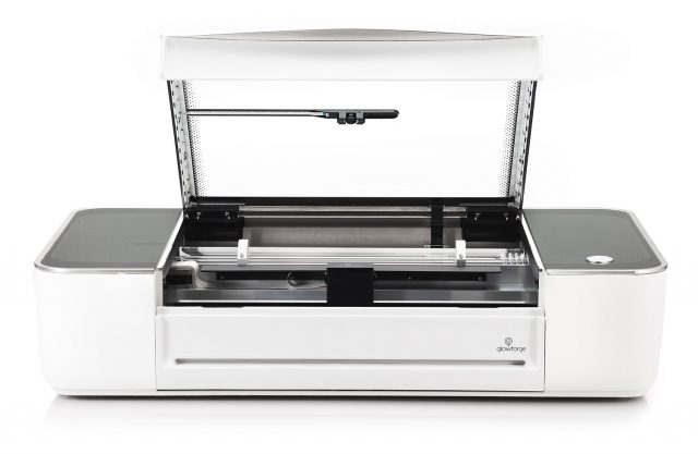 A picture of the Glowforge 2D laser cutter