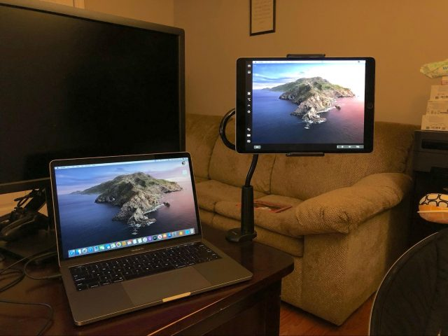 An iPad mounted to a desk.