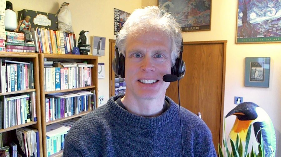 Adam Engst wearing a headset in his office