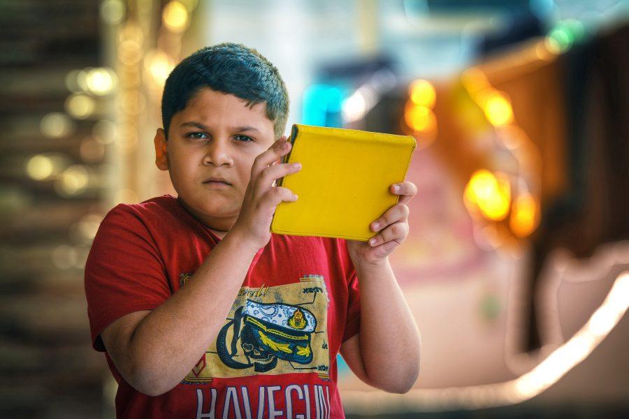 Child holding an iPad