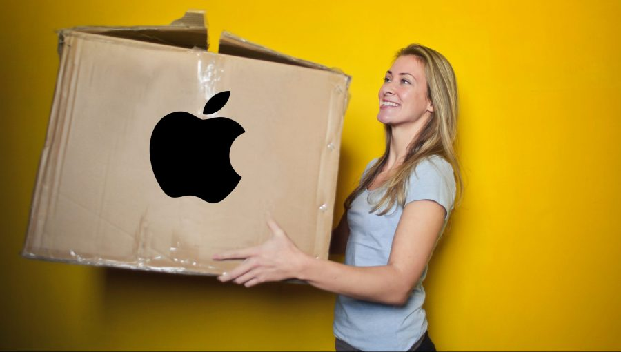 A lady carrying her Apple data in a cardboard box