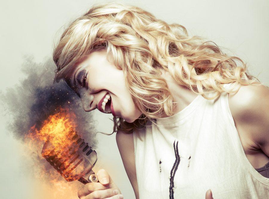 Woman singing into burning mic