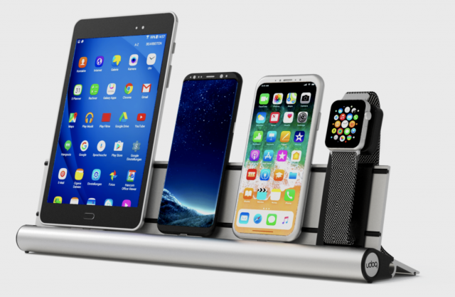 A Udoq holding a Samsung tablet, Samsung phone, iPhone X, and Apple Watch.