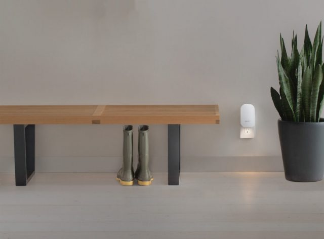 An Eero beacon with its nightlight on.