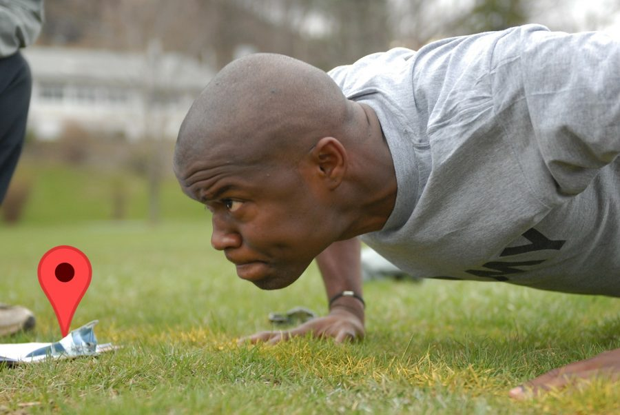 A guy doing pushups while staring at a map pin.