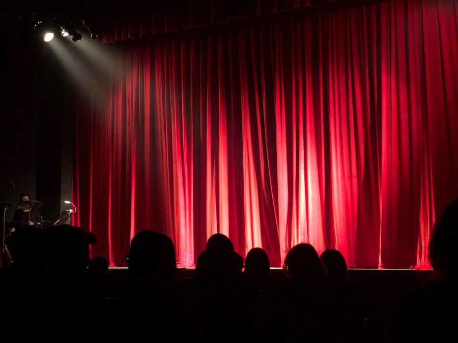 A red curtain in a theater.