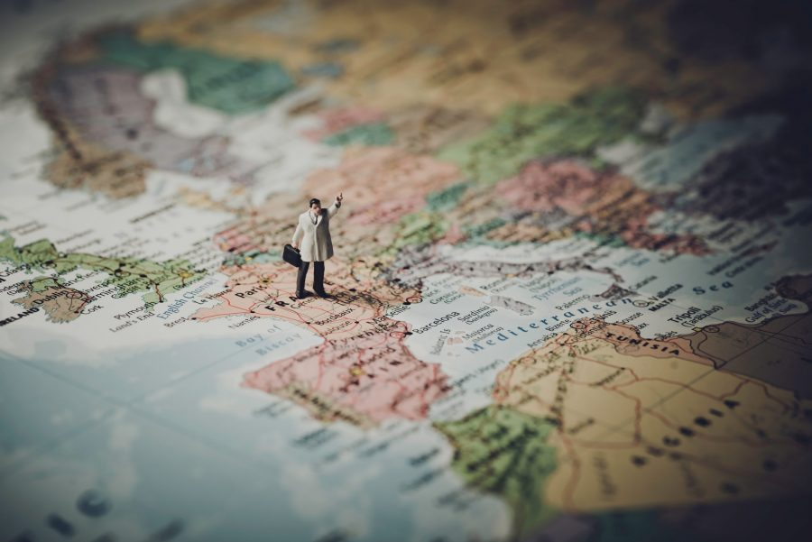 A small figure of a man on a world map.