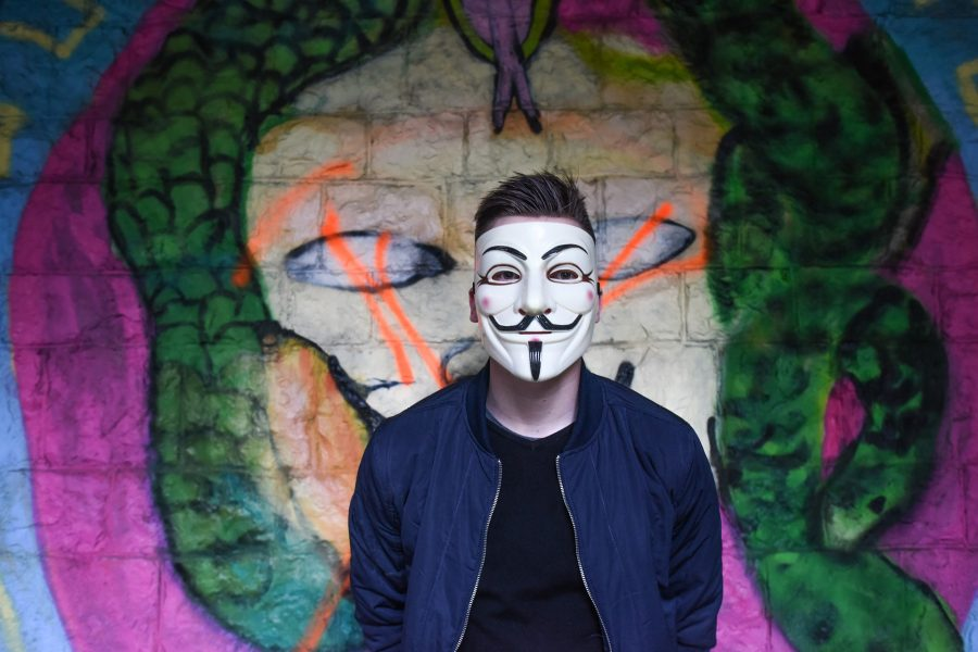 A creepy guy in an Guy Fawkes mask.