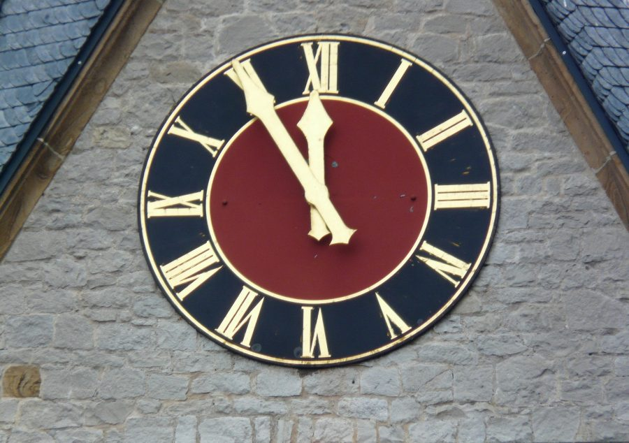 A clock about to strike 12.