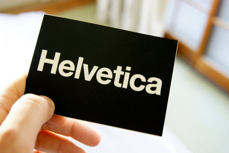 Hand holding a Helvetica card