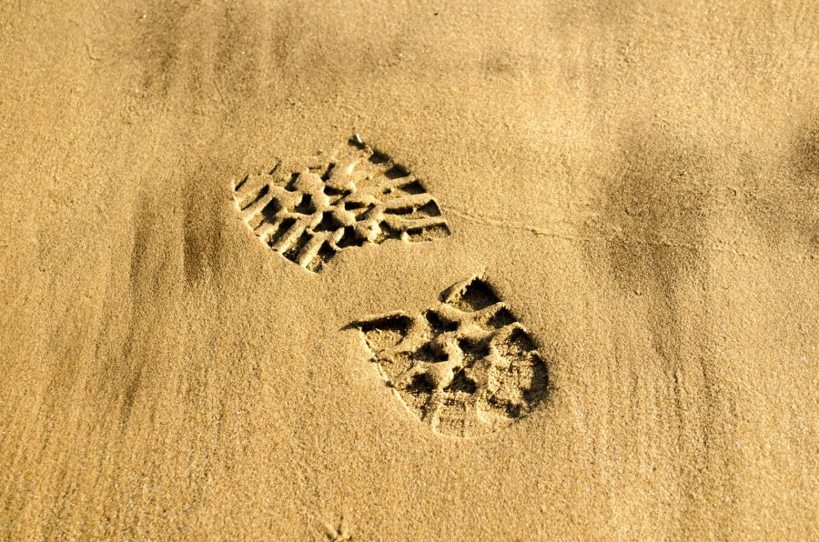 A footprint in the sand.