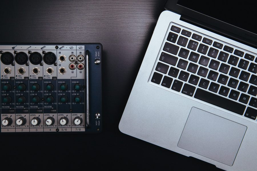 A MacBook and an analogue audio device.