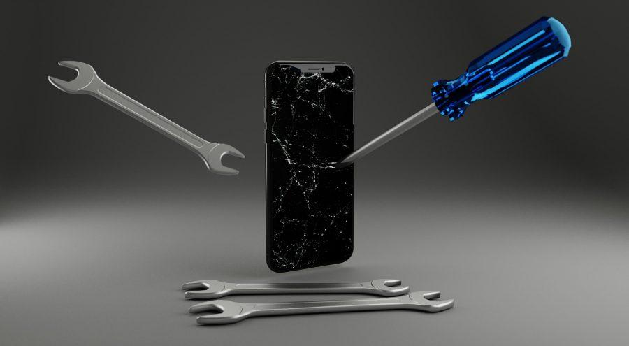 Repairing an iPhone.