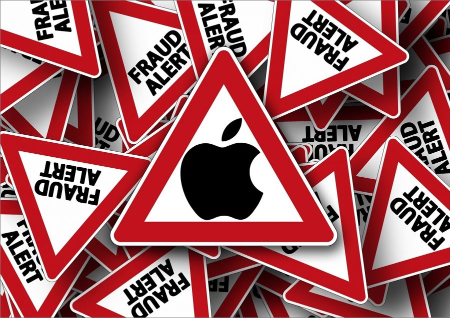 A bunch of fraud alert signs and the Apple logo.