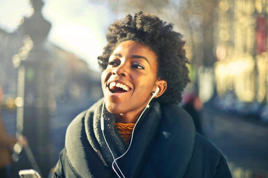 Woman listening to music on earbuds