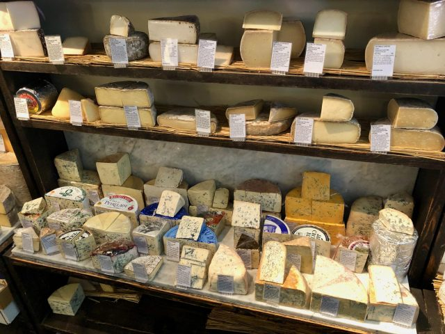 Picture of cheeses on a shelf
