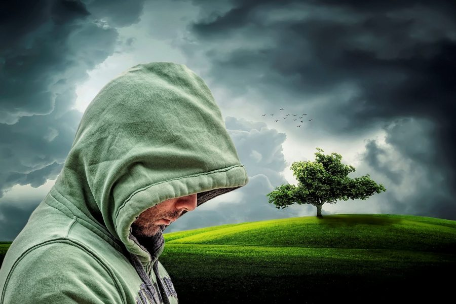 Photo of a hooded guy looking sad