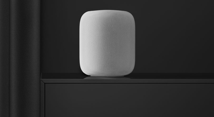 White HomePod on black table