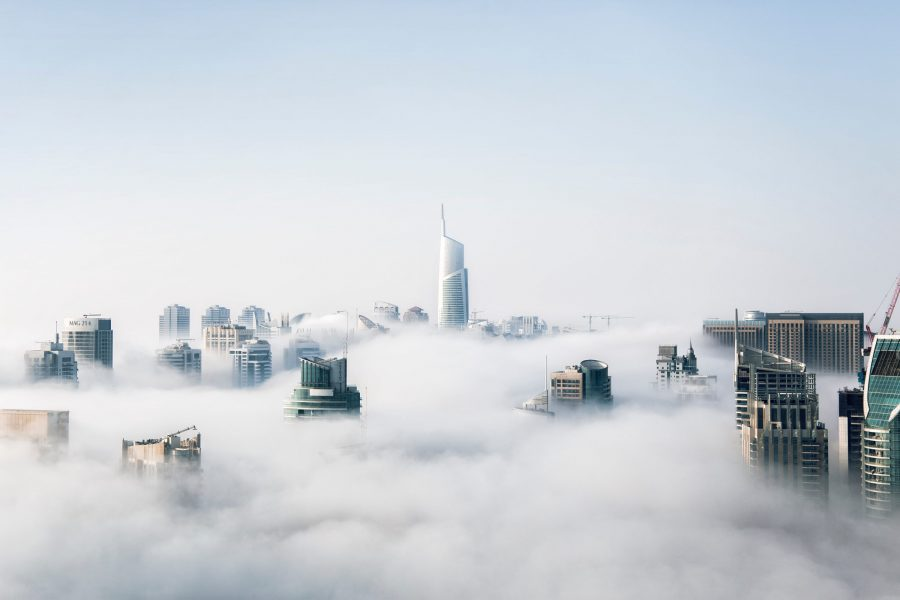 Photo of skyscrapers poking out of the clouds