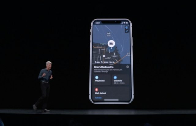 Craig Federighi in front of an iPhone showing the revised Find My app.