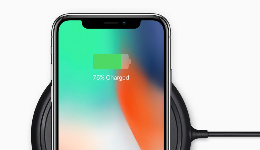 An iPhone X on a wireless charger