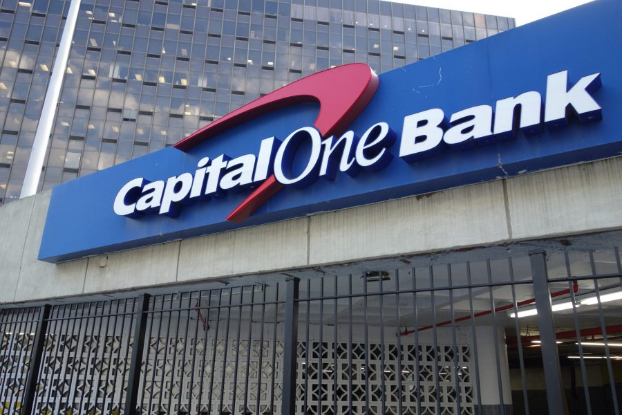A Capital One Bank sign on the parking garage for the Rego Park Office Tower (formerly Queens Tower) at Junction Boulevard between 62nd Drive and Queens Boulevard in Rego Park, Queens. The bank itself is located at the front of the building on Queens Boulevard.