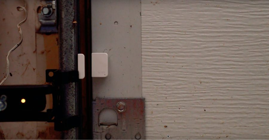 The Wyze Sense contact sensor on a door.