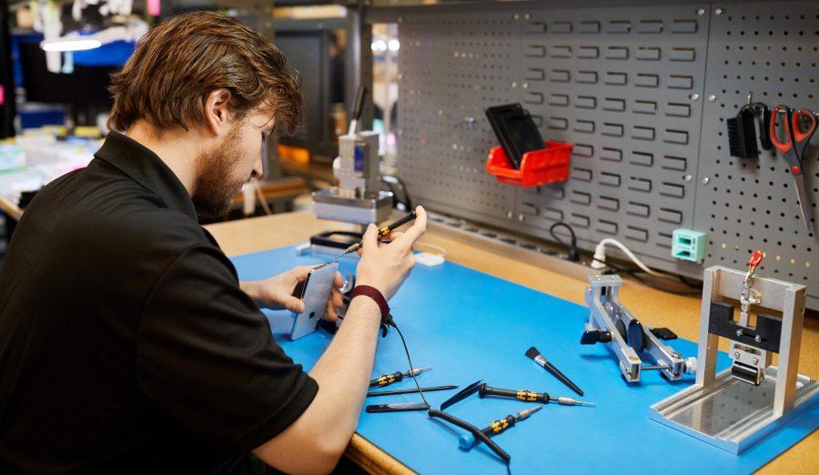 A man repairing an iPhone