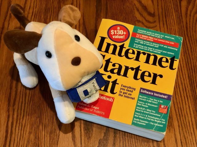 A stuffed Fetch dog and a copy of The Internet Starter Kit