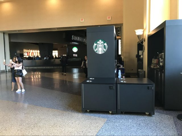 A Starbucks kiosk just outside a Starbucks