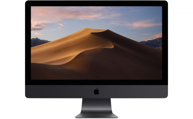 An iMac showing the Mojave desktop