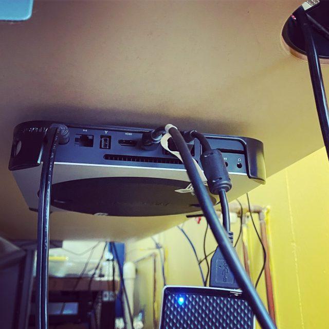 Mac mini under a desk